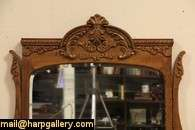 period chest or dresser has a swivel shaped and beveled mirror