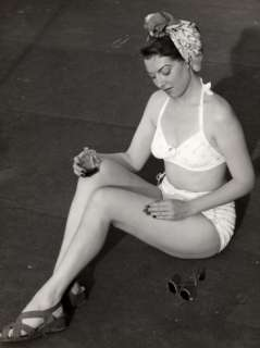 Woman Applying Sun Tan Lotion To Her Legs Photographic Print by George
