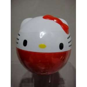 Hello Kitty Charm in Coin Capsule   Red Toys & Games