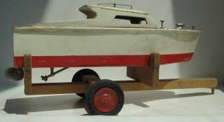 Vintage Chris Craft style wooden toy motor boat. It has the motor, a
